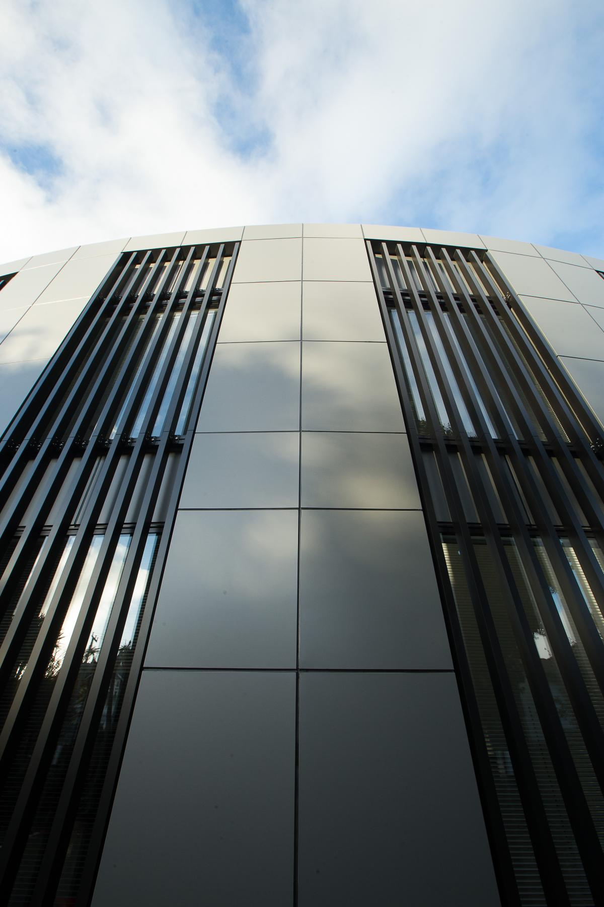 ACMF vertical louvres, commercial. Creating shade and light control, privacy and security, energy efficiencies, natural air flow.