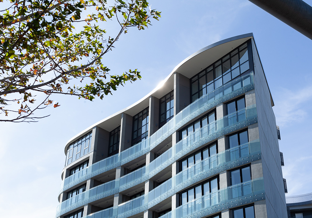 Grace Apartments, 70 Sales Street. ACMF - Lobby entry wood batterns, balcony screens and roof curve.